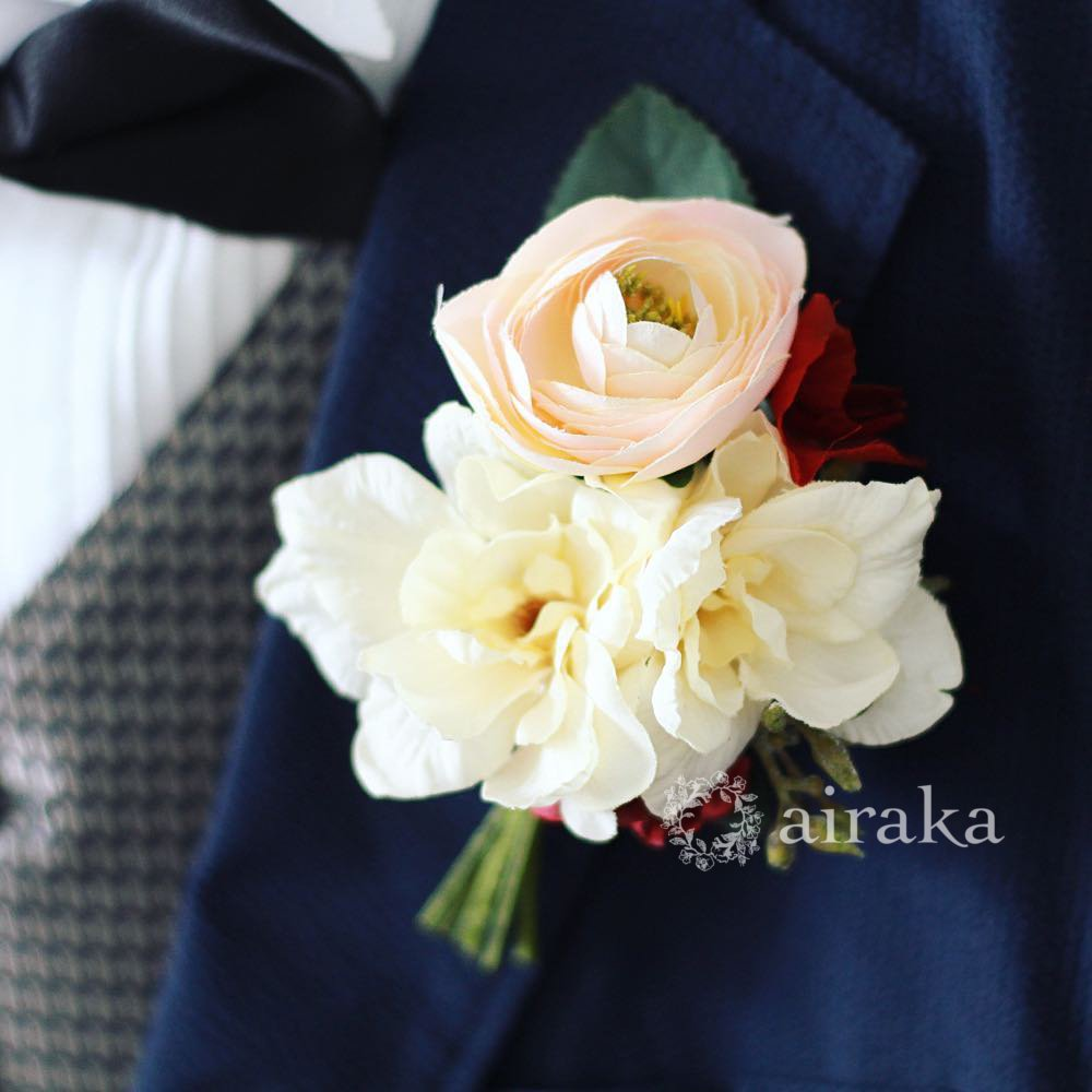 アーティフィシャルフラワー(造花)の赤いラナンキュラスのクラッチブーケ画像_airaka