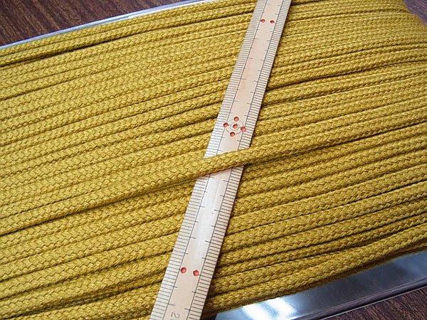 アクリルひも 黄土色 太さ約5x3mm 1反約50m 【参考画像1】