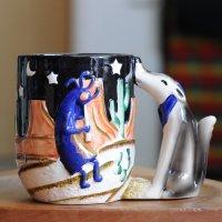 ココペリとコヨーテのマグカップ