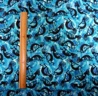 はぎれ ココペリ柄の布 ブルー柄地×黒ココペリ