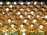 連素材◇64面カットゴールデンオーラ(加工石) 6ミリ〜12ミリ 約40センチ