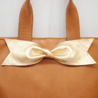 Sseko Designs:<br>Gold Bow Tote Accent