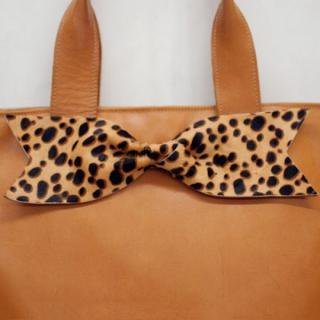 Sseko Designs:<br>Leopard Bow Tote Accent
