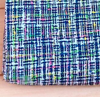 TW1249 爽やかなブルーを基調に様々な色を使用したミックスツイード生地