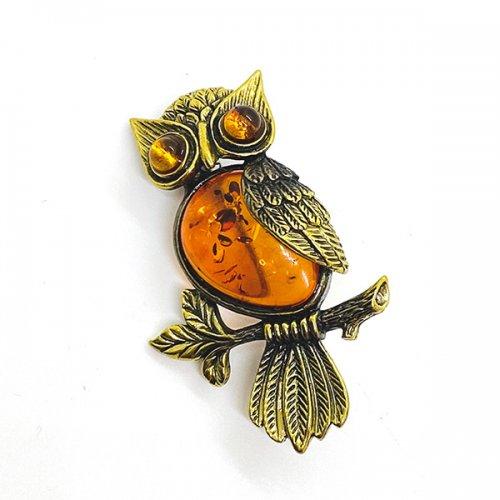 琥珀のフクロウのブローチ