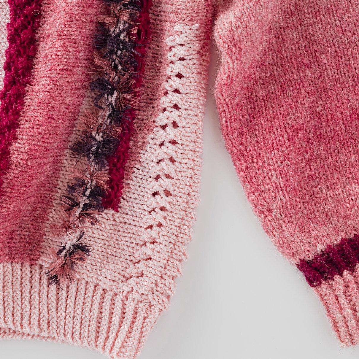 横編みアシンメトリーな柄のプルオーバー(フラッフィー)