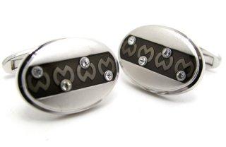mila schon(ミラ・ショーン) 楕円形ボーダーロゴパターンカフス(カフスボタン/カフリンクス) - ブランド