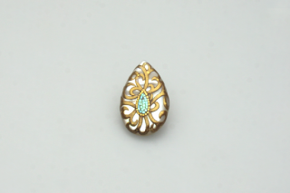 Arabesque gold drop brooch