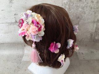 タッセルピンクのまぁるい髪飾り