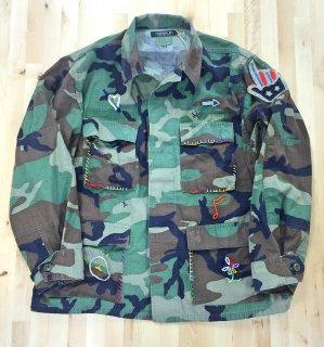 SHANANA MIL (シャナナミル) /  U.S ARMY WOODLAND CAMO JACKET(PEACE)  / ミリタリー / カモフラ / リメイク / ユニセックス
