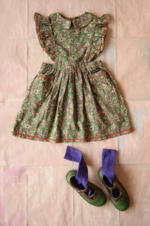 Apron dress with small green flowers