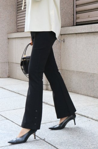 side hem button stretch flare pants / black