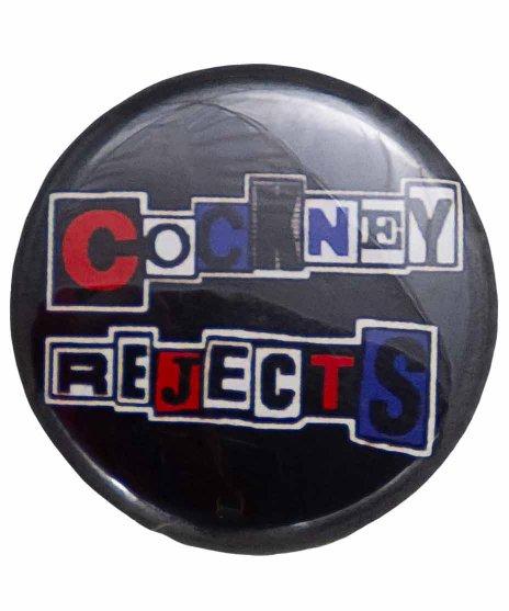 Cockney Rejects(コックニー リジェクツ) バンド缶バッジ バンドロゴサイズ:25mm<br>  材質:スチール製<br> 英国色パンクのコックニー・リジェクツのロゴデザイン