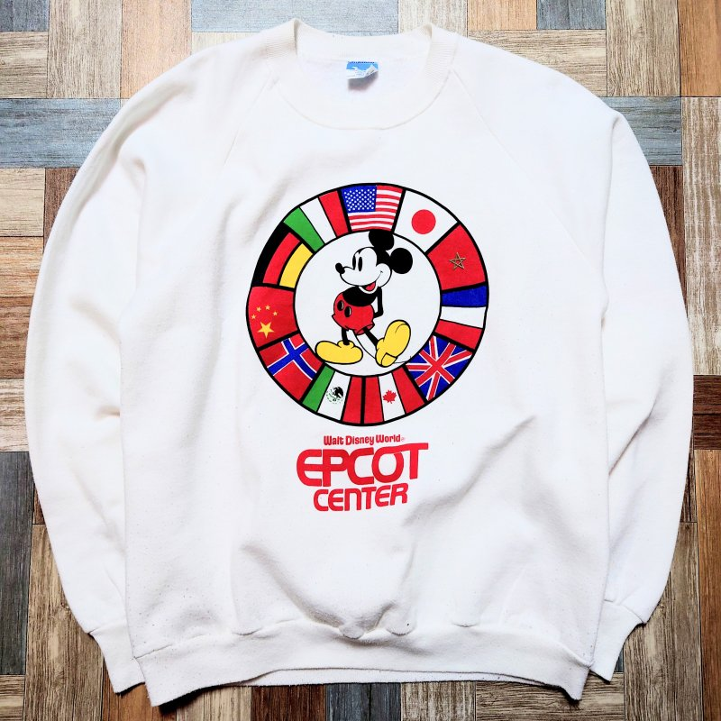 <img class='new_mark_img1' src='https://img.shop-pro.jp/img/new/icons15.gif' style='border:none;display:inline;margin:0px;padding:0px;width:auto;' />80's Vintage Disney USA製 EPCOT CENTER 国旗 ミッキーマウス スウェット ホワイト (メンズ古着)