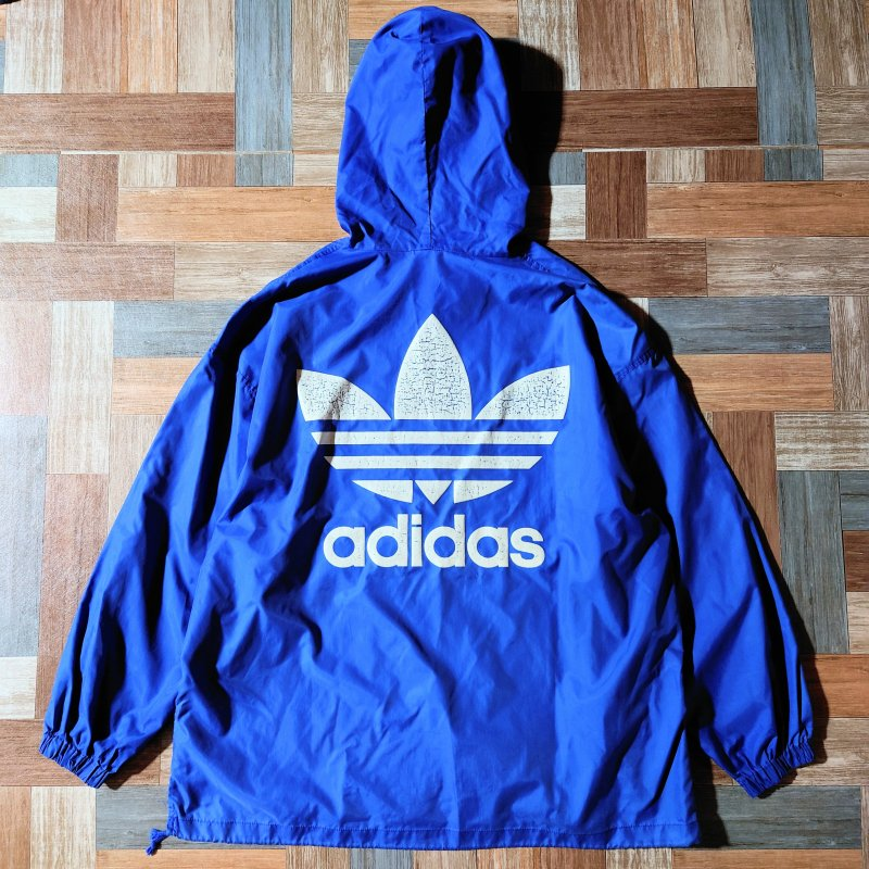 <img class='new_mark_img1' src='https://img.shop-pro.jp/img/new/icons12.gif' style='border:none;display:inline;margin:0px;padding:0px;width:auto;' />90's Vintage adidas ナイロン プルオーバー パーカー ブルー (メンズ古着)