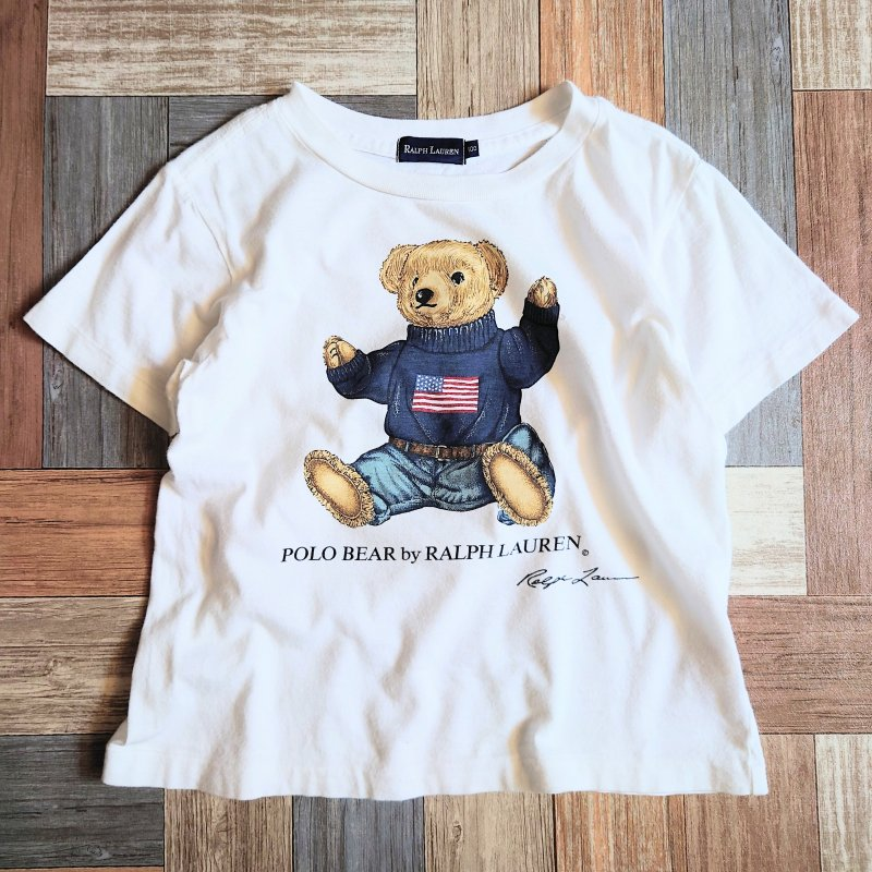 <img class='new_mark_img1' src='https://img.shop-pro.jp/img/new/icons6.gif' style='border:none;display:inline;margin:0px;padding:0px;width:auto;' />RALPH LAUREN ポロベアー Tシャツ 100サイズ ホワイト (キッズ古着)