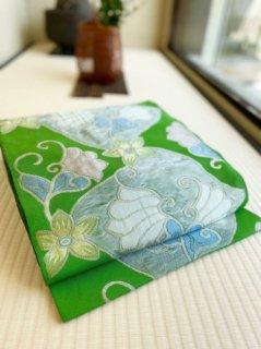 洛風林謹製 マグノリアの花 常盤色地 名古屋帯