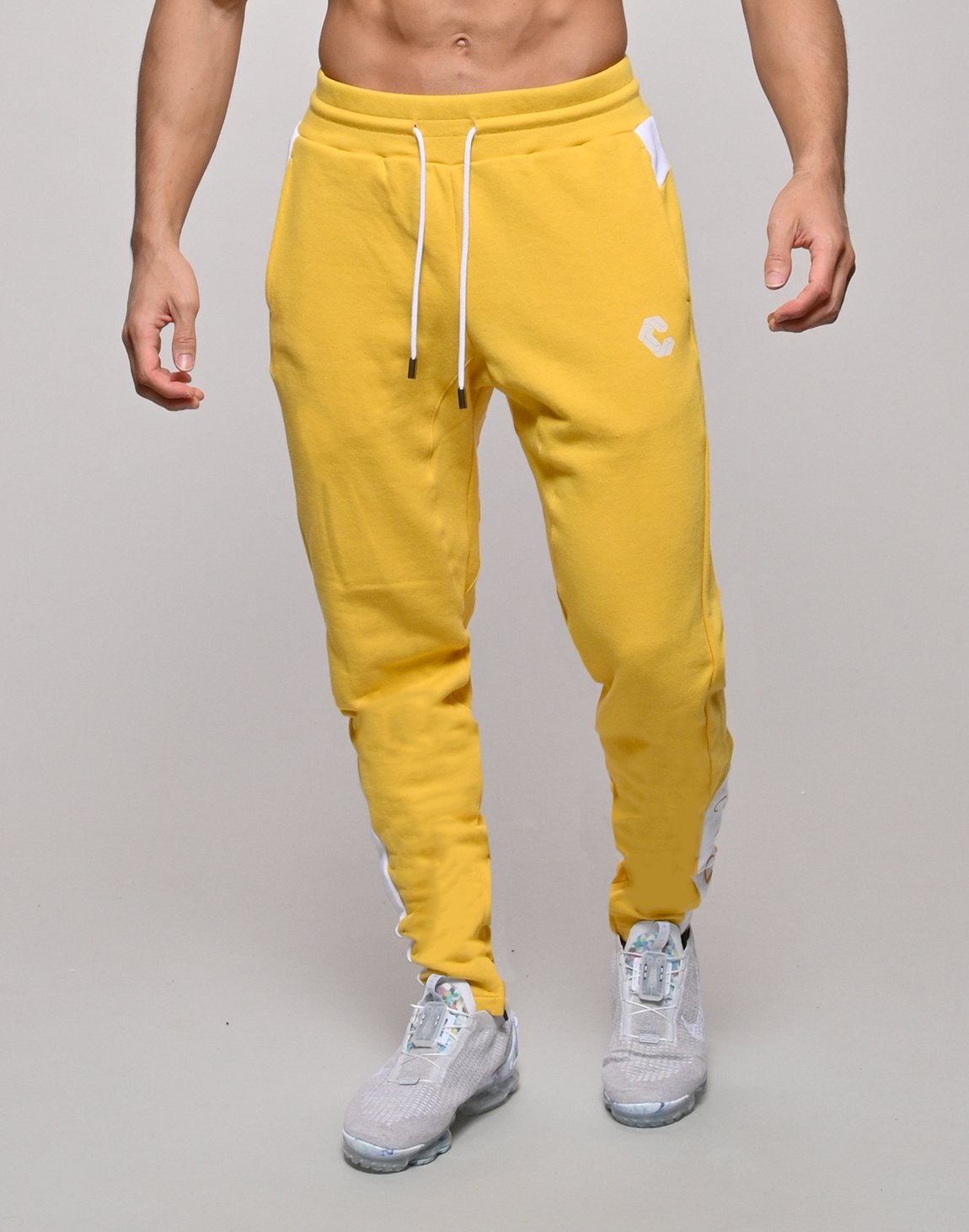<img class='new_mark_img1' src='https://img.shop-pro.jp/img/new/icons55.gif' style='border:none;display:inline;margin:0px;padding:0px;width:auto;' />CRONOS SIDE CALF LOGO SWEAT PANTS【YELLOW×WHITE】