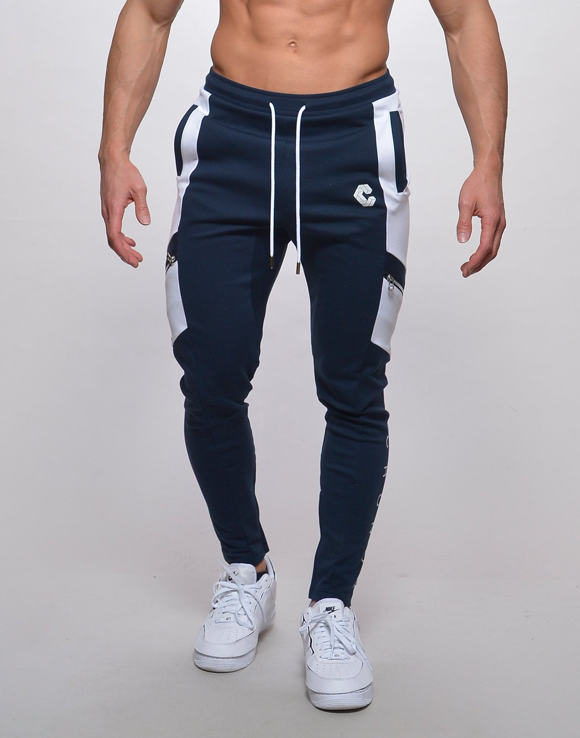 <img class='new_mark_img1' src='https://img.shop-pro.jp/img/new/icons1.gif' style='border:none;display:inline;margin:0px;padding:0px;width:auto;' />CRONOS SLANTED LINE ZIP PANTS【NAVY】