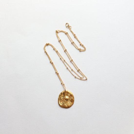 古代時計のネックレス