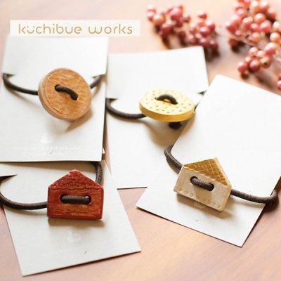 kuchibueworks(クチブエワークス) 陶器ヘアゴム ボタンモチーフの可愛い陶器ヘアゴム