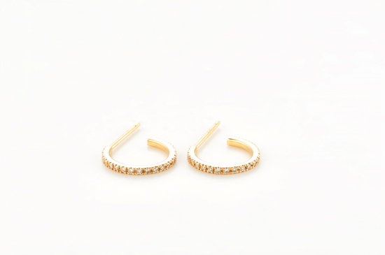 small type of c pierced earring with diamonds