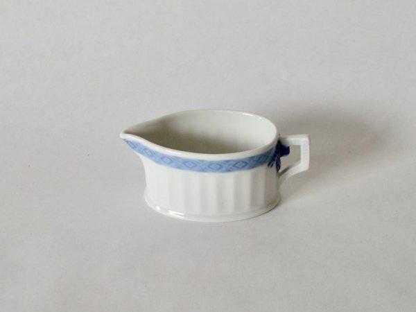 Creamer / Blue Fan