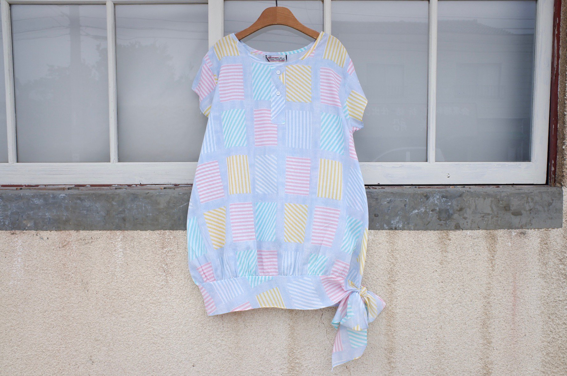 rainbow reflected in the swim ring blouse