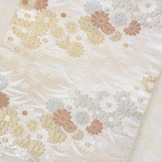 亀甲に花唐草模様の化繊袋帯