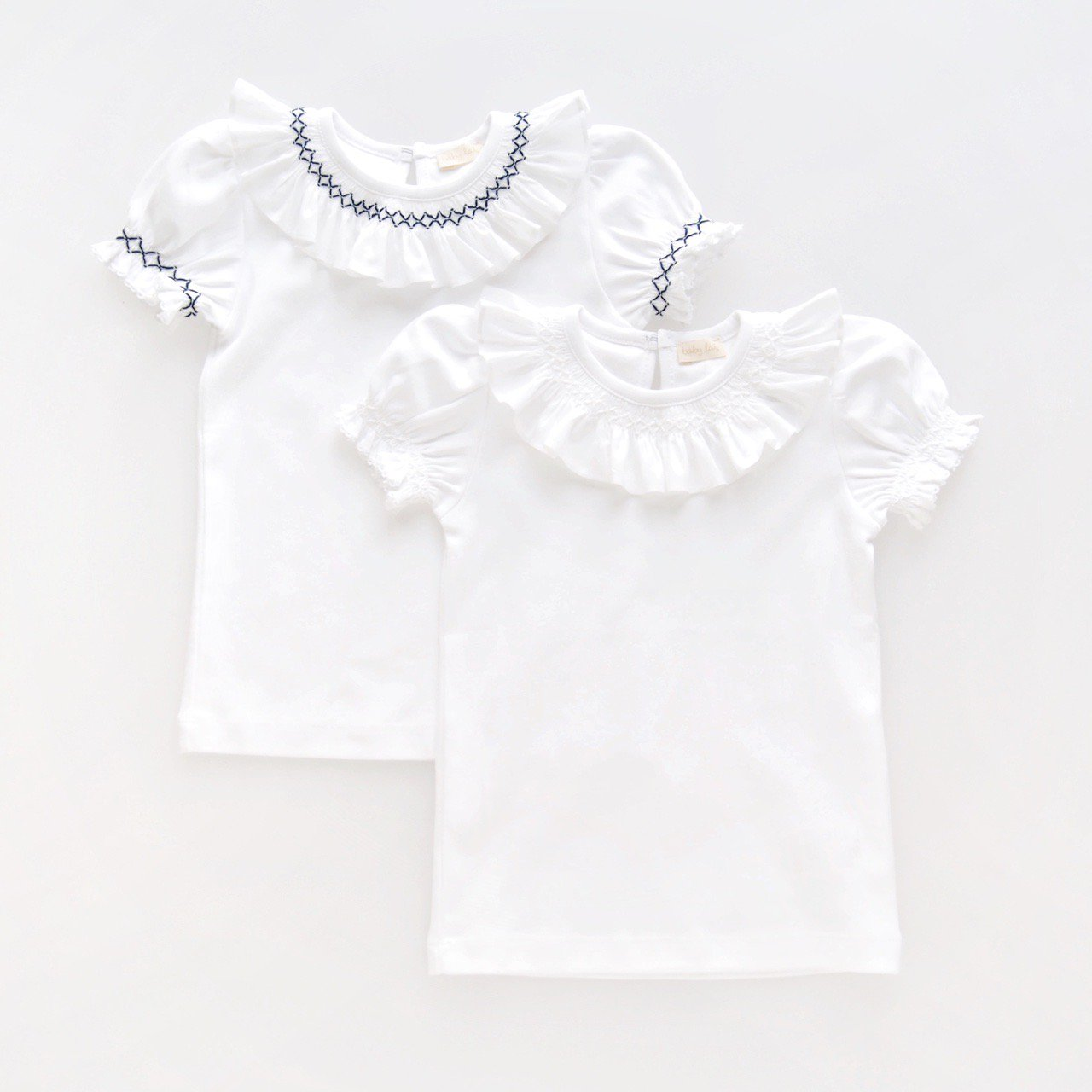<img class='new_mark_img1' src='https://img.shop-pro.jp/img/new/icons1.gif' style='border:none;display:inline;margin:0px;padding:0px;width:auto;' />baby lai/ Laivicar - Smocking T-shirts (White/ Navy)