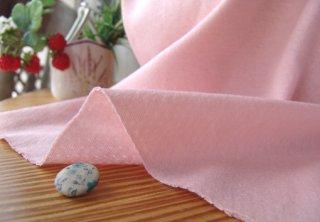 可愛いピンクの頬擦り接結ニット