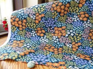 カラフルな小花パッチのコットンオックス・グリーン×オレンジ