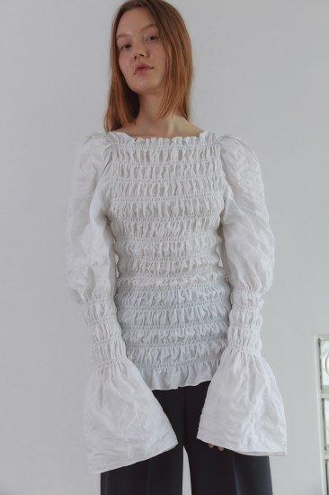 volume sleeves<br>smocked blouse<br>white