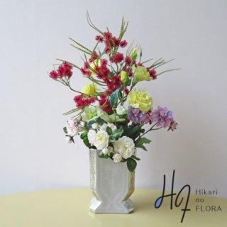 高級造花アレンジメント【ジョリ】シスル(アザミ)が主役の個性的な高級造花アレンジメントです。