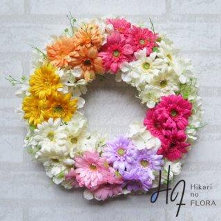 光触媒加工・壁掛けリース【wreath255】七色のガーベラの壁掛けリースです。wreath(リース)は永遠と愛の象徴です。