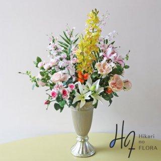 高級造花アレンジメント【アリーサ】リアルなシンビジュームとリリーが素敵な高級造花アレンジメントです。移転祝いなどにいかがでしょうか。
