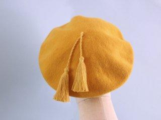 タンポポカラーのタッセルつきベレー帽