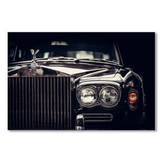 Rolls-Royce - classic British car on black background, close-up.