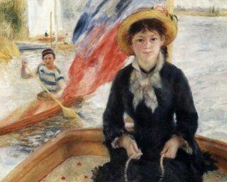 ボートに乗った女性とカヌーを漕ぐ人