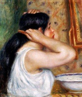 髪を梳く少女