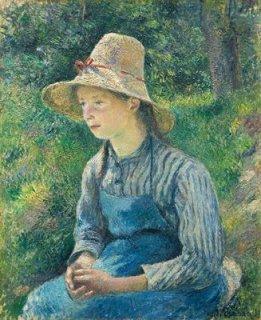 麦わら帽子を被った農家の少女