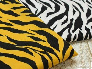 コットンツイル タイガープリント|生地 布 コットン100% 綿 トラ柄 虎 アニマルプリント 鬼のパンツ コスプレ