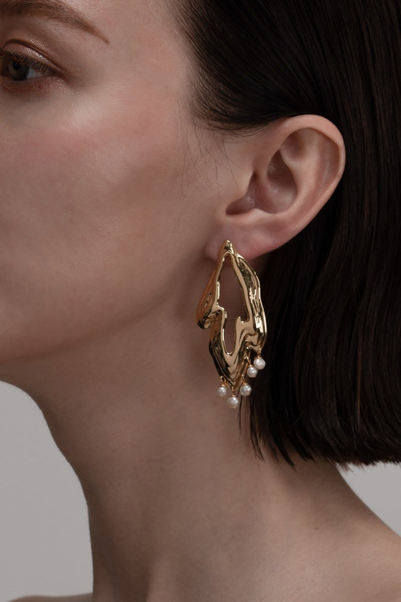 Freshwater pearl embellished pierce