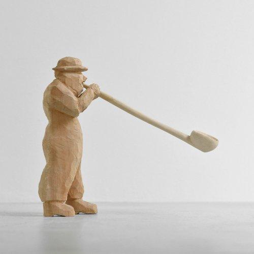 Wood Carving Blowing Man